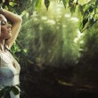 Adorable sexy brunette in a rain forest - Stockfoto