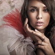 Fashion type portrait of a young beauty brunette - Stock Photo