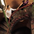 Attractive couple on the stairs — Stok fotoğraf