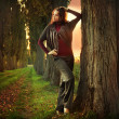 Young woman in a romantic autumn scenery — Stock Photo #4584836