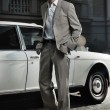 Handsome man next to the car — Stock Photo #4585445