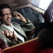 Screaming man in the car - Stockfoto