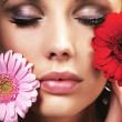Beauty brunette with flowers — Stok fotoğraf