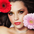 Portrait of a beauty lady with flowers — Stock Photo