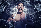 Muscular man having shower — Stock Photo