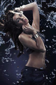 Young beauty dancing with water splash — Stockfoto