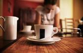 Cute brunette on a coffee-break — Stock Photo
