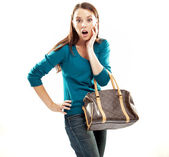 Young shocked brunette shopping isolated on white — Stock Photo