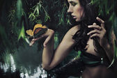 Portrait of a beauty brunette with butterfly — ストック写真