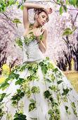 Stunning brunette in a spring garden — Photo