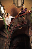 Attractive couple on the stairs — Stock Photo