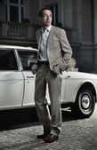 Handsome man next to the car — Stock Photo