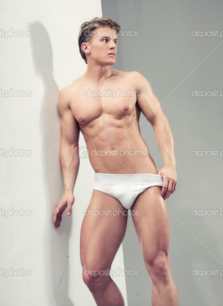 Handsome muscular guy in the studio   Stock Photo #4580076