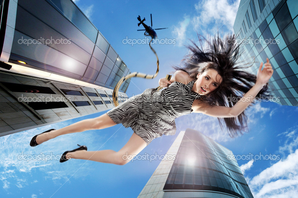 Young brunette falling down the sky  — Stock Photo #4580296