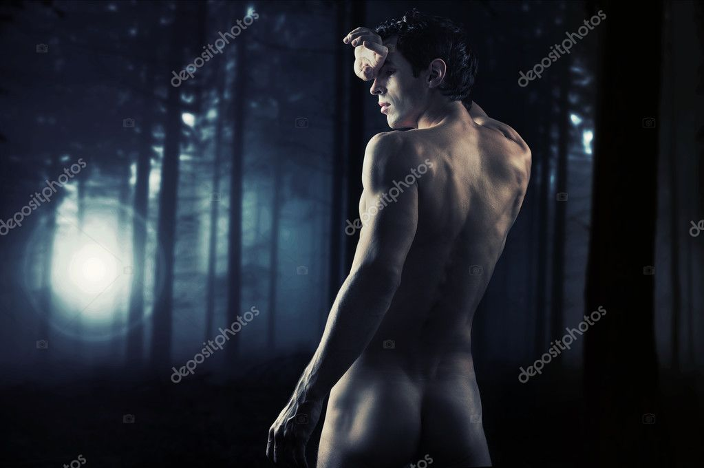 Fine art photo of a young muscular man in a forest  — Stock Photo #4584895