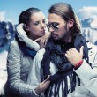 Stock Photo: Fashionable couple posing over alpine mountains