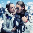 Стоковое фото: Fashionable couple posing over alpine mountains