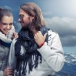 Fashionable couple posing over alpine mountains — Stock Photo