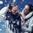 Handsome couple in winter snow — Stock Photo