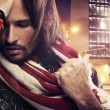 Handsome man wearing scarf — Stock Photo