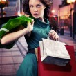 Young woman with shopping bag — Stok fotoğraf