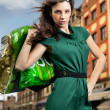 Young woman with shopping bag — Foto de Stock