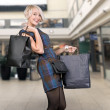 Cute blonde holding papperbag - Stock Photo