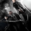 Handsome men with weapons — Stock Photo