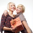 Two blond beauties holding a christmas present — Stockfoto #4597019