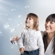 Smiling woman and her daughter — Stock Photo