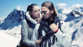 Fashionable couple posing over alpine mountains — ストック写真