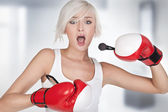 Young beauty doing make up in boxing gloves — Stock Photo