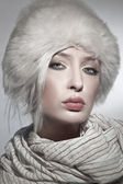 Beautiful young lady wearing fur hat — Stock Photo