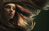 Portrait of a young woman with long hair — Stok fotoğraf