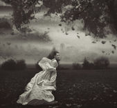 Fine art photo of a woman in beauty scenery — Stock Photo