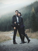 Young couple in nature scenery — Stock Photo