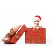 Cheerful santa woman in a christmas box — Stock Photo