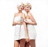Smiling girls in towels — Stock Photo