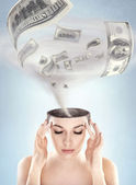 Dollars tornado in woman's head — Stockfoto