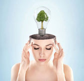 Open minded woman with green energy symbol — Stock Photo