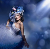 Beauty brunette in white dress — Stock Photo