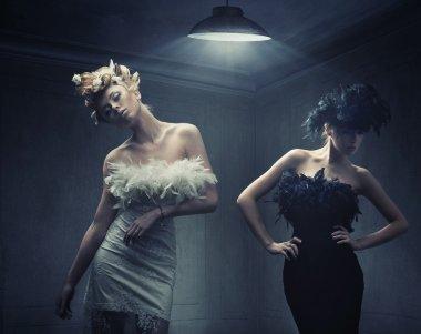 Vogue style photo of two fashion ladies