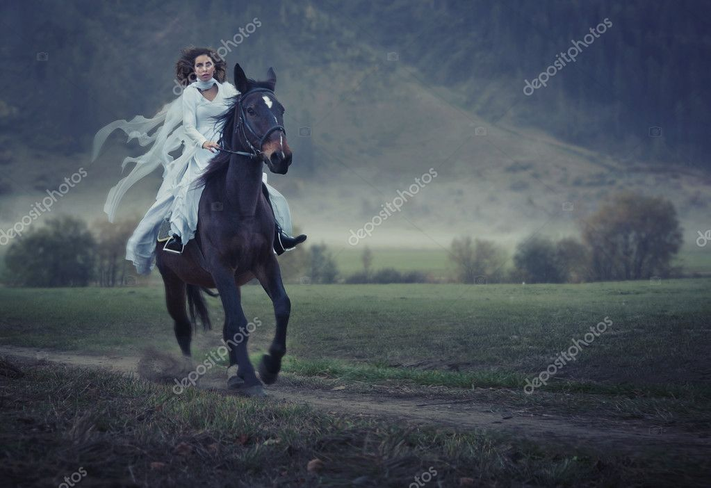 Sensual young beauty riding a horse  Stock Photo #4594995
