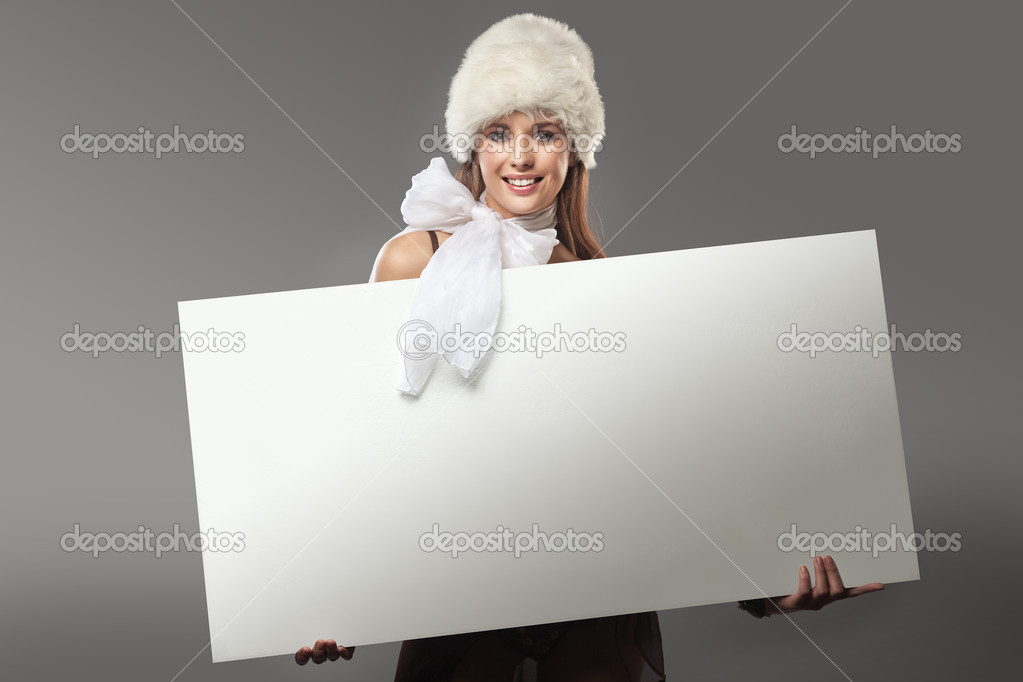 Young happy woman over white board  — Stockfoto #4596112