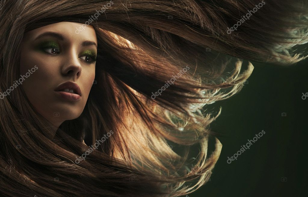 Portrait of a young woman with long hair   Foto de Stock   #4596194