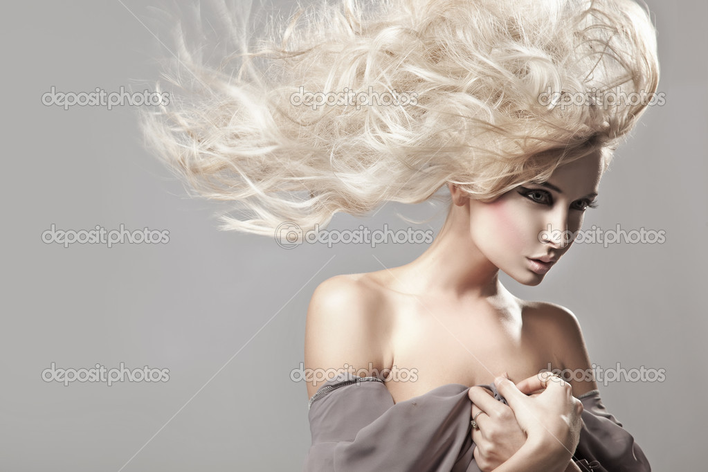 Portrait of a woman with long blonde hair     #4596956