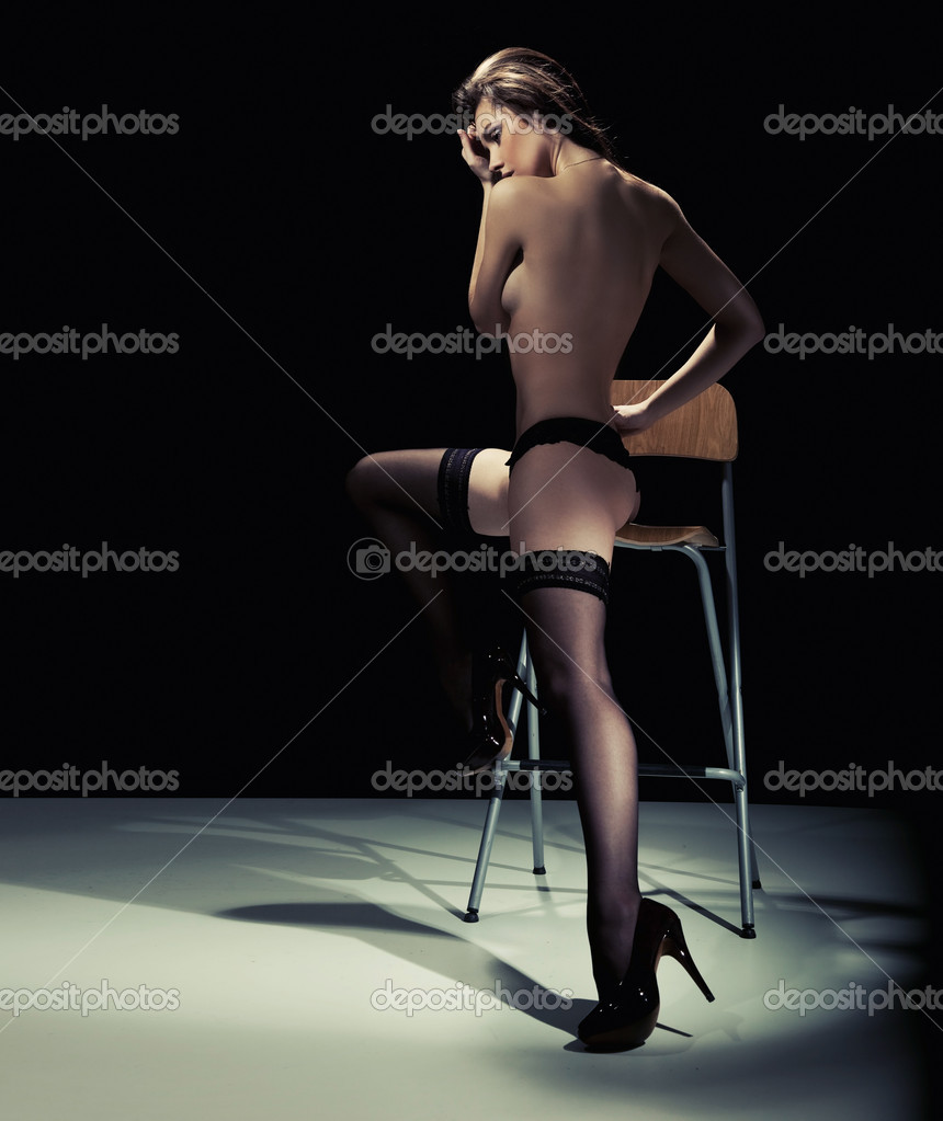 Sexy woman sitting on the chair  — Stock Photo #4597276