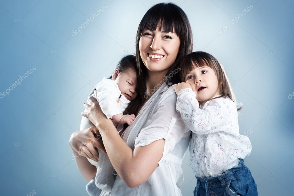 Loving mother holding son and daughter — Stock Photo #4597297