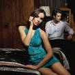 Young beauty and handsome man sitting in bedroom — Stok fotoğraf