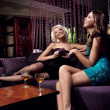 Pretty young girls talking and drinking on the party — ストック写真